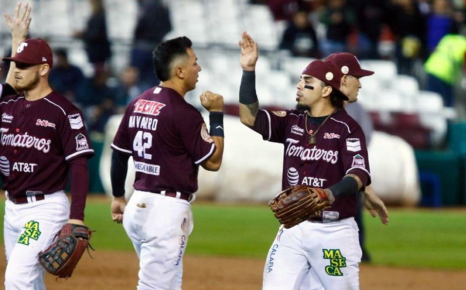 Navarro y Elizalde, pilares del primer triunfo de los playoffs. (Foto: Tomateros.com.mx)